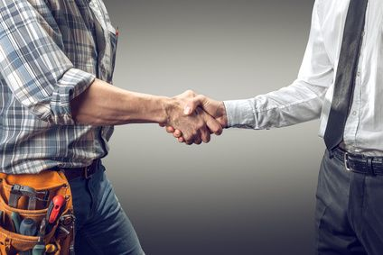 goal-driven hvac sales team member shaking hands with a businessman