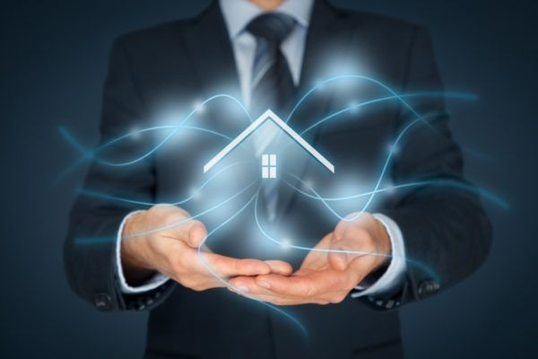 Man-with-house-image-and-light-in-hands-demonstrating-bank-marketing-with-mortgage-crm